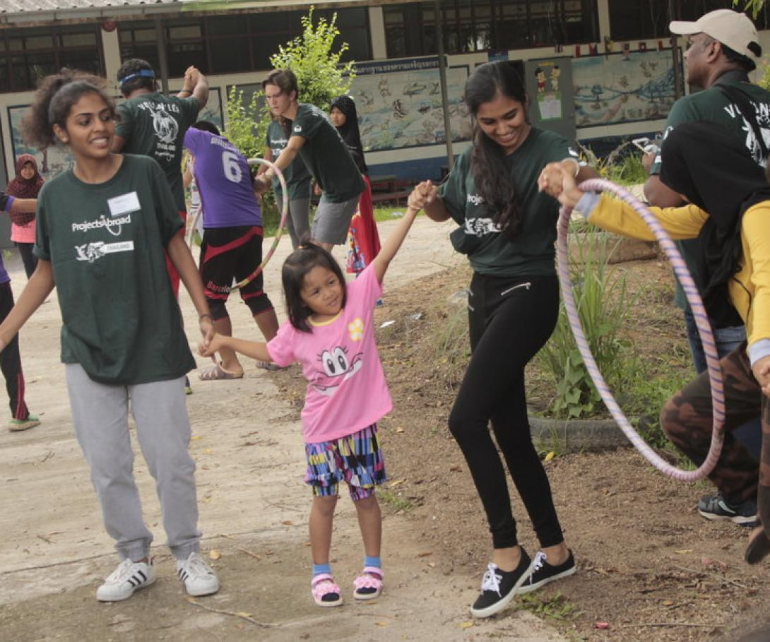 A group of volunteers from the Canadian International School in India play a game with kids in Thailand.